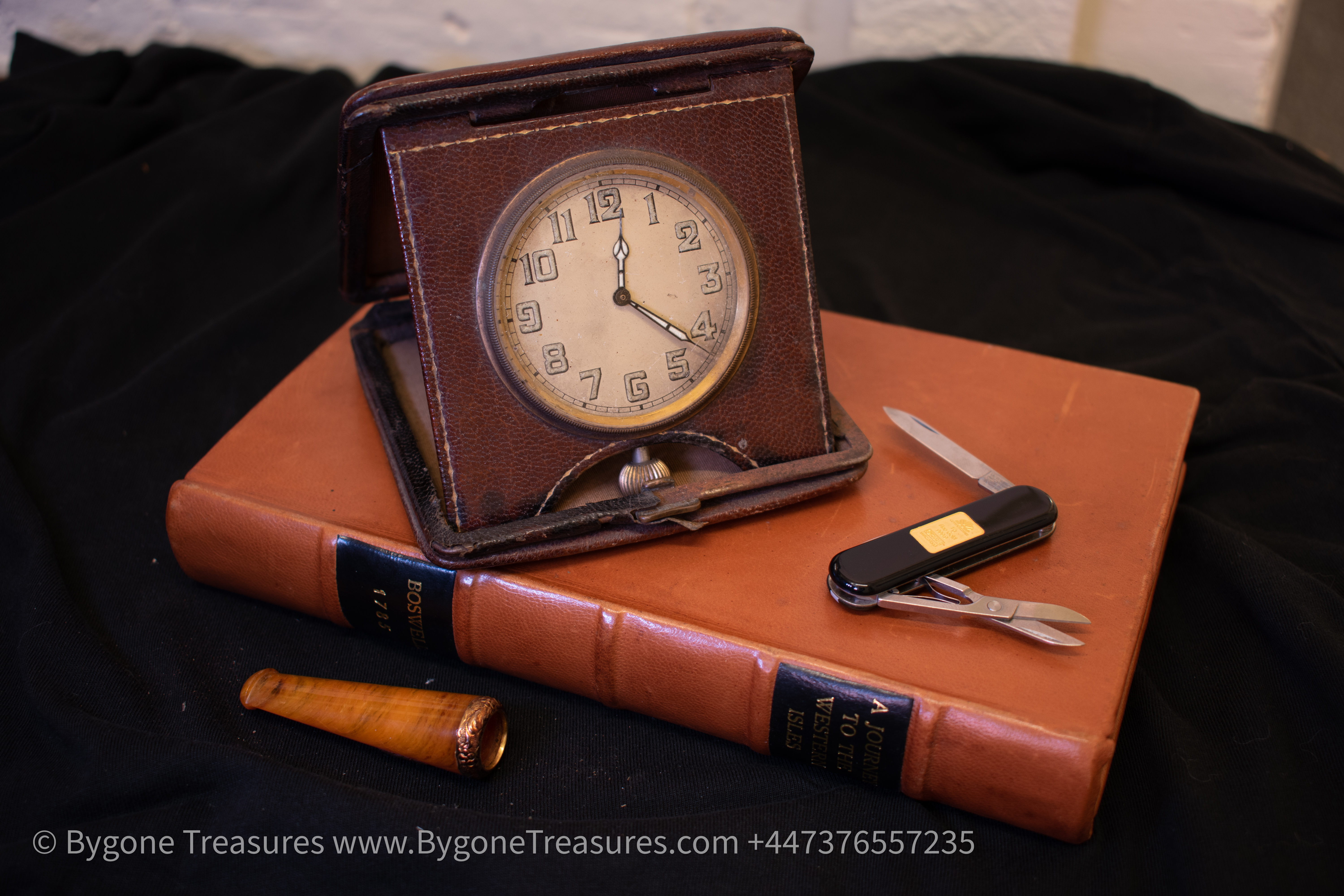 Travel clock – Swiss made – 1920's art deco – brown leather case