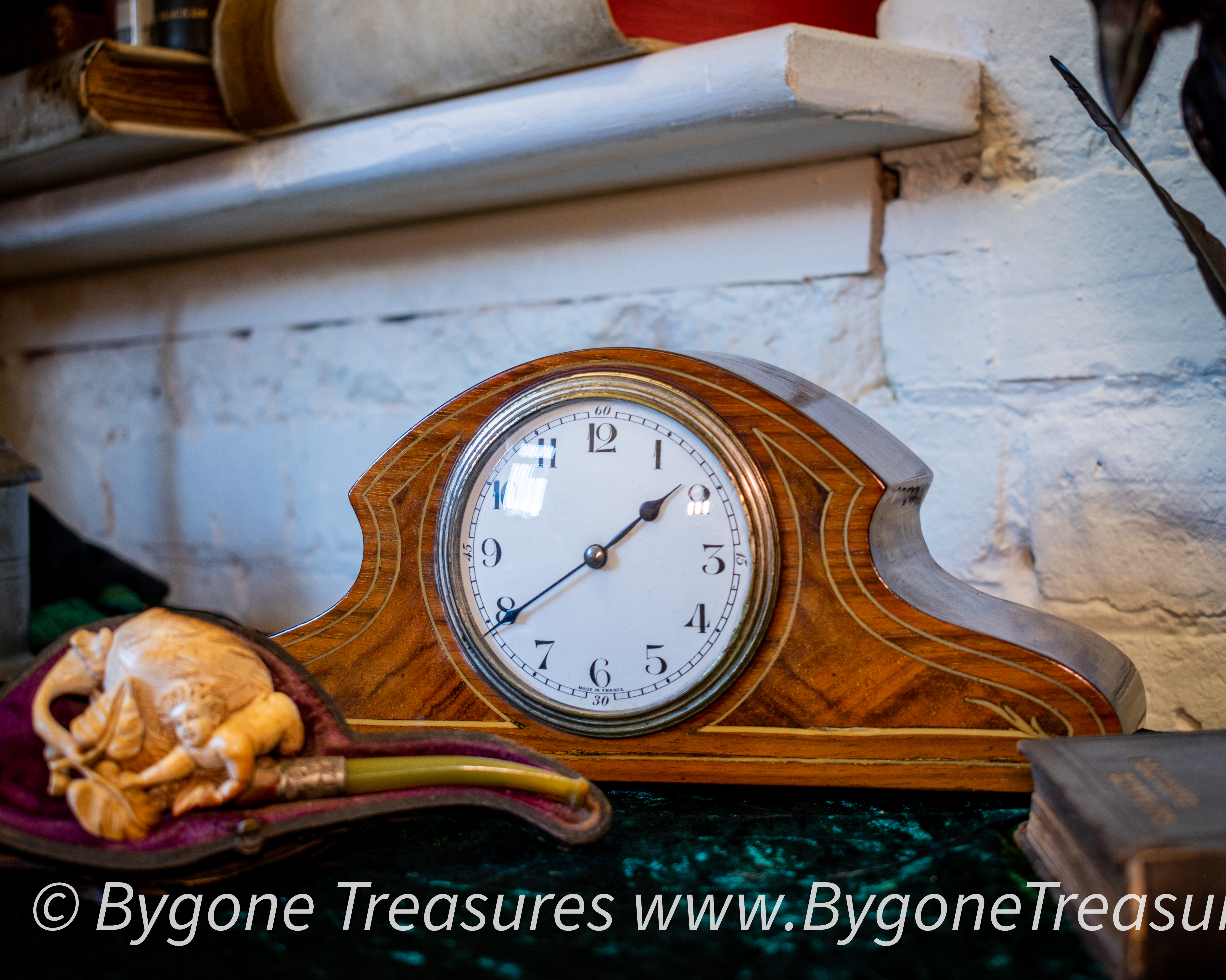 Napoleon style clock with fruit wood inlay and brass button feet-01